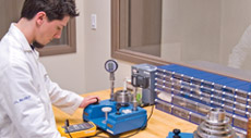 One of the lab technicians repairing a humidity instrument
